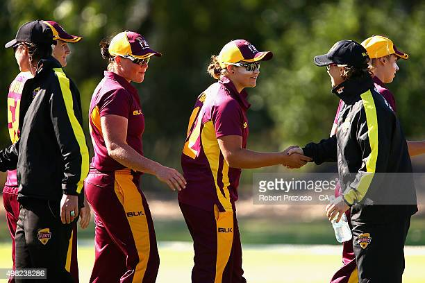 Ash Barty of Queensland shakes hands with Western Australia players during the WNCL match between Queensland and Western Australia at Park 25 on...