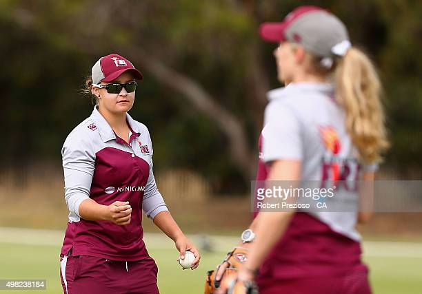 Ash Barty of Queensland warms up with teammates during the WNCL match between Queensland and Western Australia at Park 25 on November 22 2015 in...