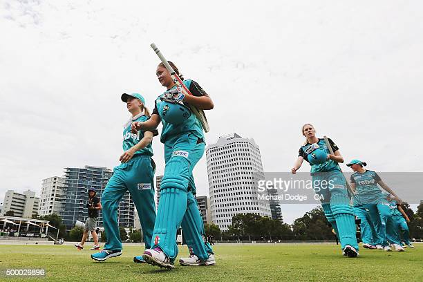 Ash Barty of the Heat walks off after her innings during the Women's Big Bash League match between the Brisbane Heat and the Melbourne Stars at...
