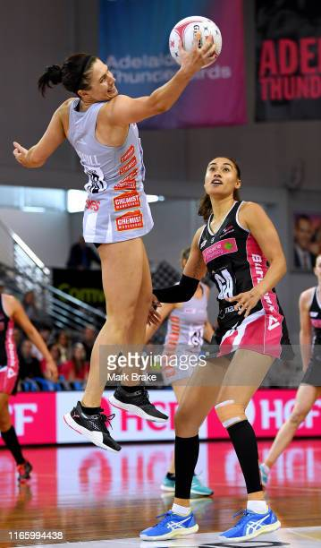 Ash Brazill of the Magpies catches in front of Maria Folau of the Thunderbirds during the round 11 Super Netball match between the Thunderbirds and...