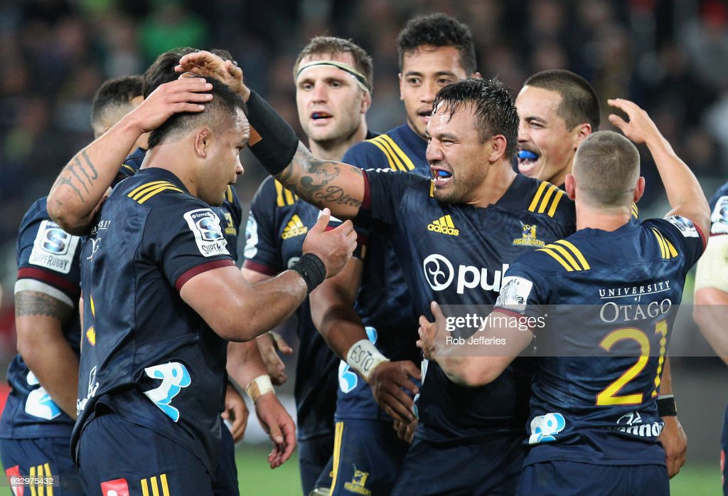 Ash Dixon of the Highlanders celebrates with his team-mates during the round five Super Rugby match between the Highlanders and the Crusaders at Forsyth Barr Stadium on March 17, 2018 in Dunedin, New Zealand.