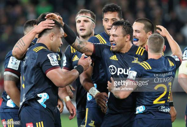 Ash Dixon of the Highlanders celebrates with his teammates during the round five Super Rugby match between the Highlanders and the Crusaders at...