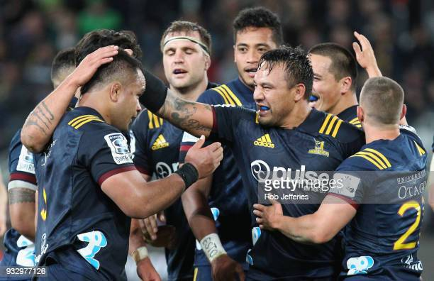 Ash Dixon of the Highlanders celebrates with his team-mates during the round five Super Rugby match between the Highlanders and the Crusaders at...