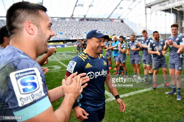 Ash Dixon of the Highlanders is congratulated in a guard of honour after playing his 100th game following the round 10 Super Rugby Aotearoa match...