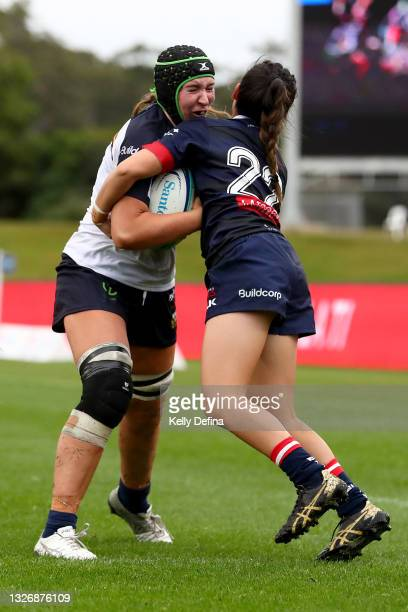 Ash Fernandez of the Brumbies is tackled by Kirsty Matapa of the Rebels during the Super W match between the Melbourne Rebels and the ACT Brumbies at...