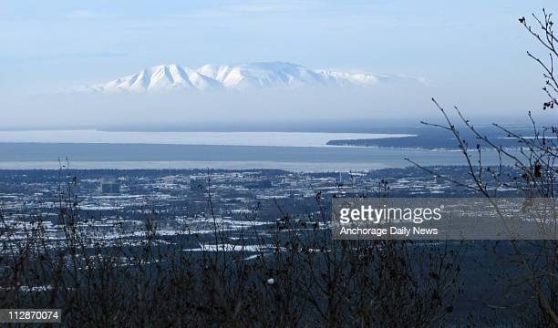 Ash from the eruption of the Mount Redoubt volcano obscures the lower slopes of Mt. Susitna near Anchorage, Alaska, Monday, March 23, 2009. Anchorage...