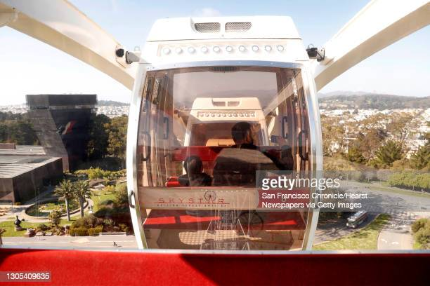 Ash Holmes and his son, Alex take a ride on the SkyStar Wheel as the attraction reopens in Golden Gate Park in San Francisco, Calif., on Thursday,...