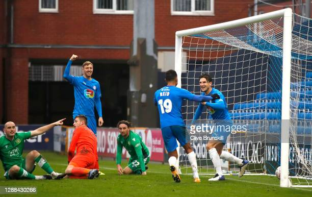 Ash Palmer of Stockport County celebrates with team mate Alex Reid after scoring their sides second goal as Charlie Lee of Yeovil Town reacts during...