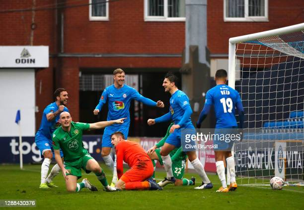 Ash Palmer of Stockport County celebrates with team mates after scoring their sides second goal as Carl Dickinson of Yeovil Town reacts during the...