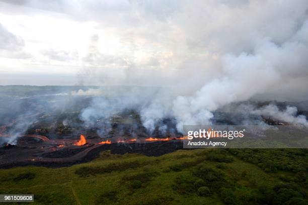 Ash plume rises from forest following a massive volcano eruption on Kilauea volcano in Hawaii United States on May 22 2018 Lava is spewing more than...