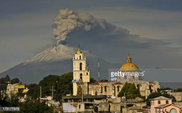 Ash spews from Mexico's Popocatepetl volcano some 55 km from Mexico City as seen from San Damian Texoloc in the Mexican central state of Tlaxcala on...