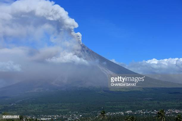 TOPSHOT Ash spews from the Mayon volcano as it continues to erupt seen from the city of Legazpi in Albay province south of Manila on January 23 2018...