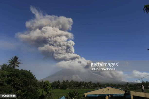 Ash spews from the Mayon volcano as it continues to erupt seen from the town of Daraga in Albay province south of Manila on January 23 2018 A giant...