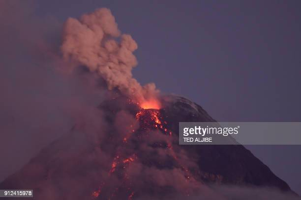 TOPSHOT Ash spews from the Mayon volcano seen from the Philippine city of Legazpi in Albay province south of Manila early on January 31 2018 Nearly...