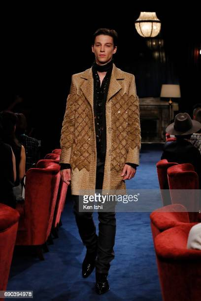 Ash Stymest showcases designs by CHANEL on the runway during the CHANEL Metiers D'art Collection Paris Cosmopolite show at the Tsunamachi Mitsui Club...