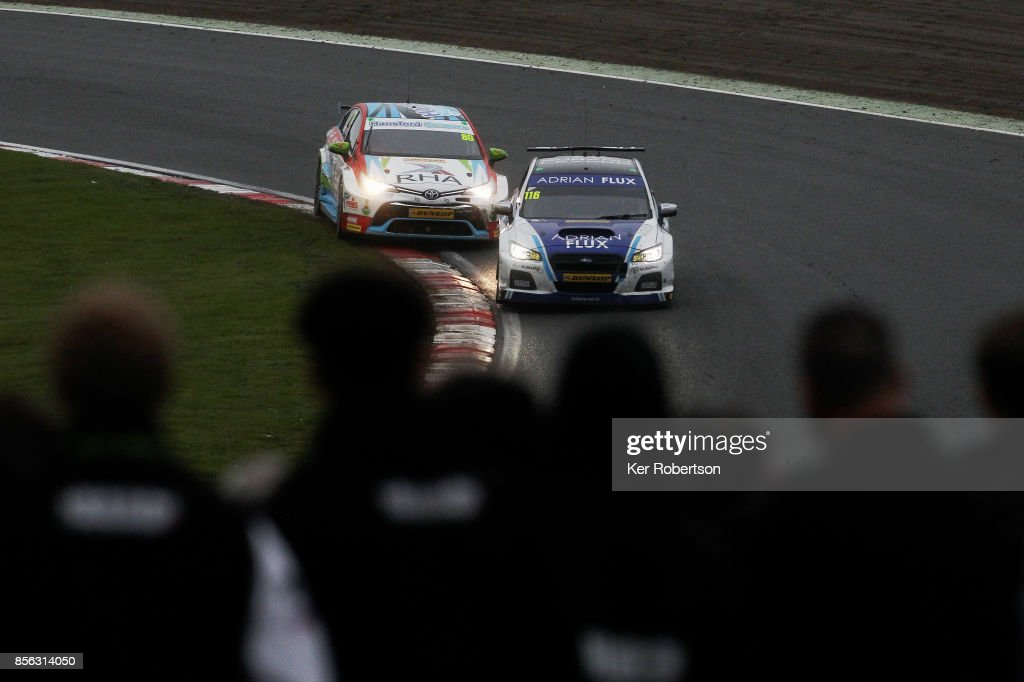 Ash Sutton (R) of Adrian Flux Subaru Racing drives side by side with Tom Ingram (L) of Speedworks Motorsport on his way to winning this years British Touring Car Championship after the final race at Brands Hatch on October 1, 2017 in Longfield, England.
