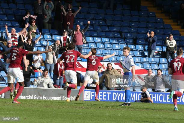 Ash Taylor of Northampton Town celebrates after scoring his sides third goal during the Sky Bet League One match between Bury and Northampton Town at...