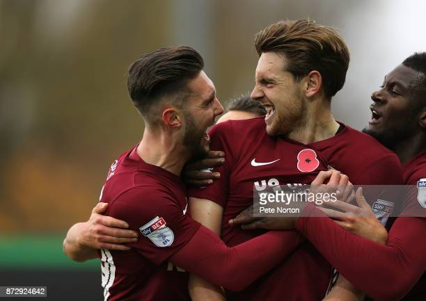 Ash Taylor of Northampton Town celebrates with team mate Matt Grimes after scoring his sides first goal during the Sky Bet League One match between...