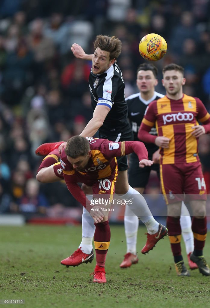 Ash Taylor of Northampton town contests the ball with Paul Taylor of Bradford City during the Sky Bet League One match between Bradford City and Northampton Town at The Northern Commercials Stadium, Valley Parade on January 13, 2018 in Bradford, England.
