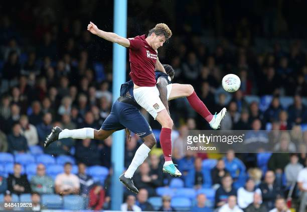 Ash Taylor of Northampton Town heads the ball under pressure from Nile Ranger of Southend United during the Sky Bet League One match between Southend...