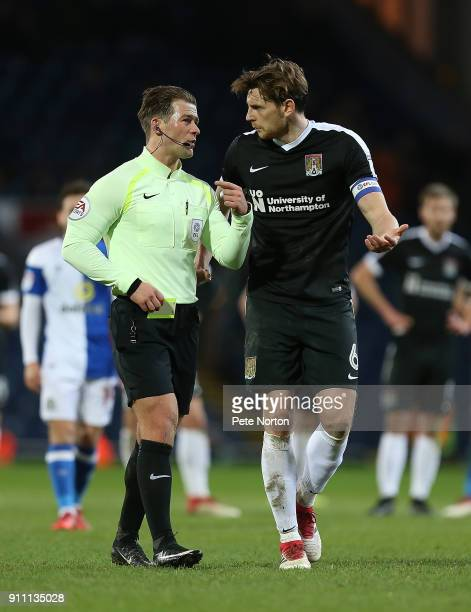 Ash Taylor of Northampton Town makes a point to referee Anthony Backhouse during the Sky Bet League One match between Blackburn Rovers and...