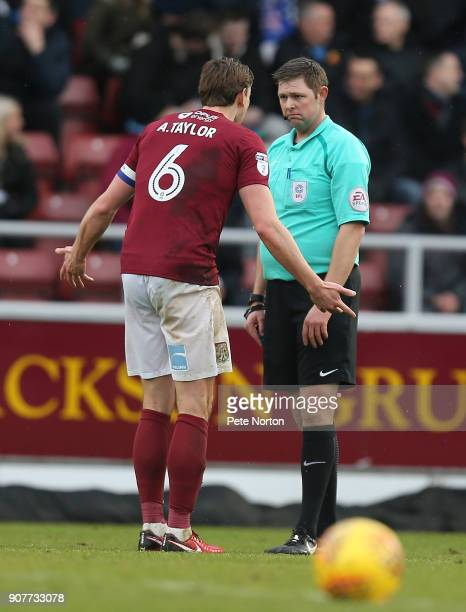 Ash Taylor of Northampton Town makes his point to referee Brett Huxtable during the Sky Bet League One match between Northampton Town and Milton...