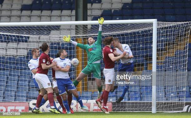 Ash Taylor of Northampton Town scores his sides first goal during the Sky Bet League One match between Bury and Northampton Town at Gigg Lane on...