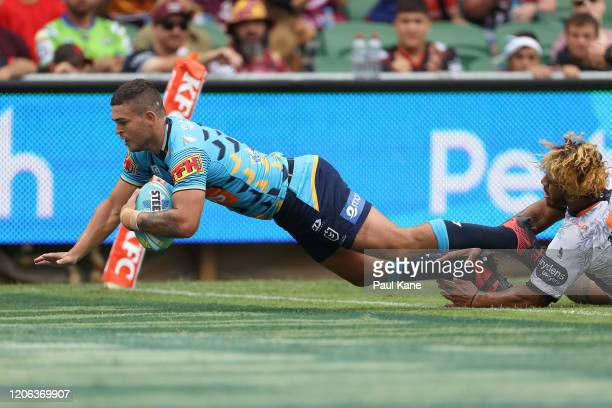 Ash Taylor of the Titans crosses for a try during Day 2 of the 2020 NRL Nines between the Gold Coast Titans and the Wests Tigers at HBF Stadium on...