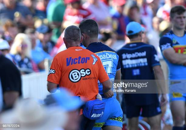 Ash Taylor of the Titans is taken from the field with an injury during the round three NRL match between the Gold Coast Titans and the St George...