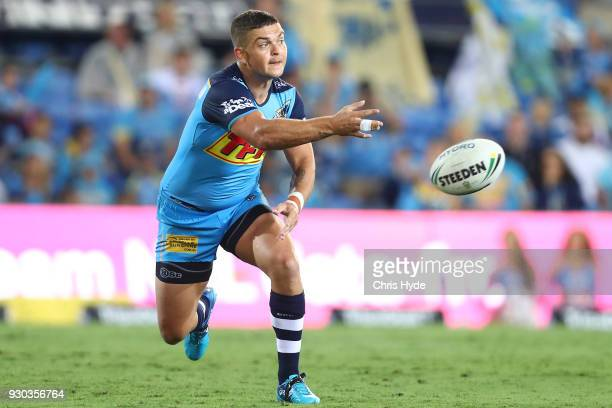 Ash Taylor of the Titans passes during the round one NRL match between the Gold Coast Titans and the Canberra Raiders at Cbus Super Stadium on March...