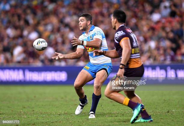 Ash Taylor of the Titans passes the ball during the round four NRL match between the Brisbane Broncos and the Gold Coast Titans at Suncorp Stadium on...