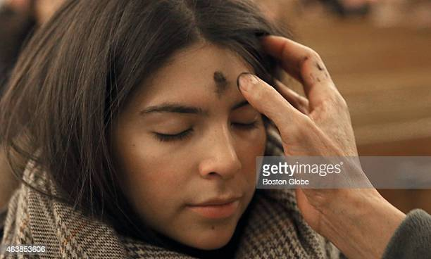 Ash Wednesday at Saint Anthony Shrine in Boston Maria Rincon from Boston gets a cross of ashes applied to her forehead