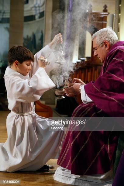Ash wednesday celebration at Notre Dame du Travail Roman catholic church Paris France