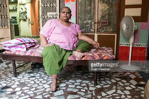 Asha a Hijra guru at her Gharana in the Old City Vadodara Gujarat India Hijras or transgender people make up a very large group in Indian society and...