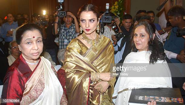 Asha Bhonsle Rekha and Jaya Bachchan at the launch of Chehere a coffee table book compiled by celebrity photographer Gautam Rajadhakshya in Mumbai on...
