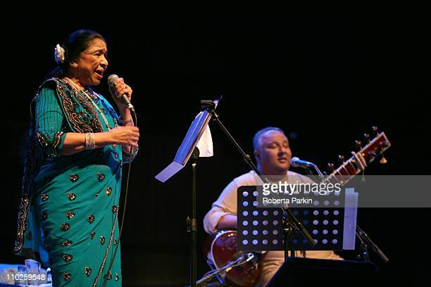 Asha Bhosle and Shujaat Khan perform on stage at the Royal Festival Hall on March 16 2011 in London United Kingdom