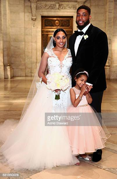 Asha Joyce and husband Devon Still pose with daughter Leah Still after The Knot Dream Wedding NFL Player Devon Still Marries Asha Joyce on May 13...