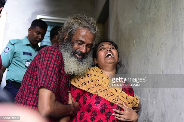 Asha Moni the wife of murdered Bangladeshi blogger Niloy Chakrabarti who used the penname Niloy Neel weeps outside her home in Dhaka on August 8 2015...