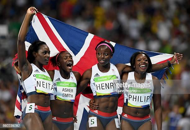 Asha Philip Desiree Henry Dina AsherSmith and Daryll Neita of Great Britain celebrate winning bronze in the Women's 4 x 100m Relay Final on Day 14 of...