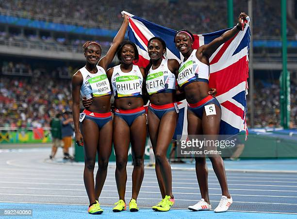 Asha Philip Desiree Henry Dina AsherSmith and Daryll Neita of Great Britain celebrate winning bronze in the Women's 4 x 100m Relay Final on Day 14 of...