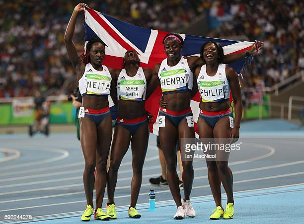 Asha Philip, Desiree Henry, Dina Asher-Smith and Daryll Neita pose after Great Britain win Bronze in the Women's 4 x 100m Final on Day 14 of the Rio...