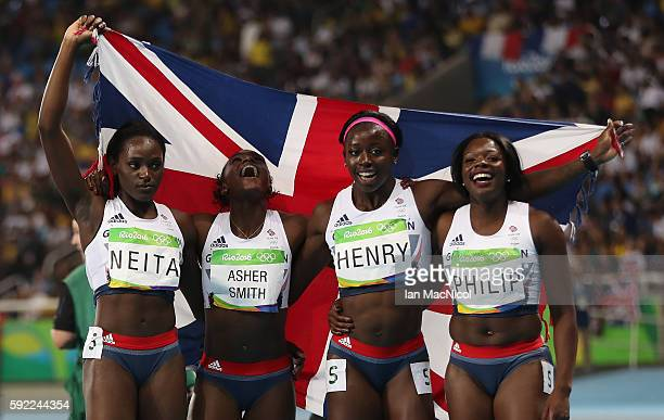 Asha Philip Desiree Henry Dina AsherSmith and Daryll Neita pose after Great Britain win Bronze in the Women's 4 x 100m Final on Day 14 of the Rio...