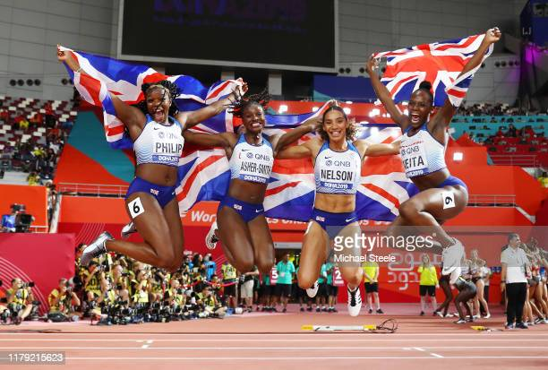 Asha Philip, Dina Asher-Smith, Ashleigh Nelson and Daryll Neita of Great Britain celebrate silver in the Women's 4x100 Metres Relay during day nine...