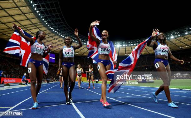 Asha Philip Imani Lansiquot Bianca Williams and Dina AsherSmith of Great Britain celebrate winning gold competes in the Women's 4x100 metres relay...