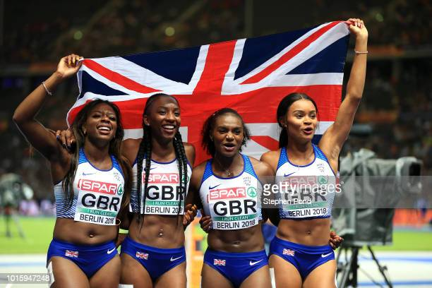 Asha Philip Imani Lansiquot Bianca Williams and Dina AsherSmith of Great Britain celebrate winning gold in the Women's 4x100 metres relay final...