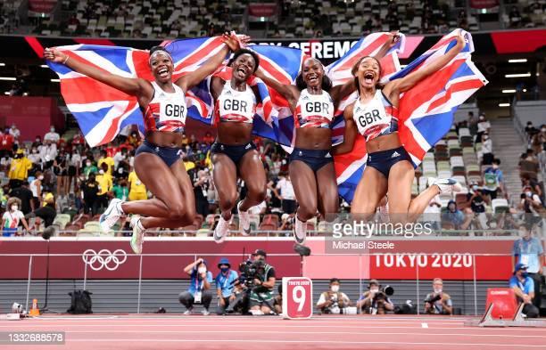 Asha Philip, Imani Lansiquot, Dina Asher-Smith and Daryll Neita of Team Great Britain celebrate winning the bronze medal in the Women's 4 x 100m...