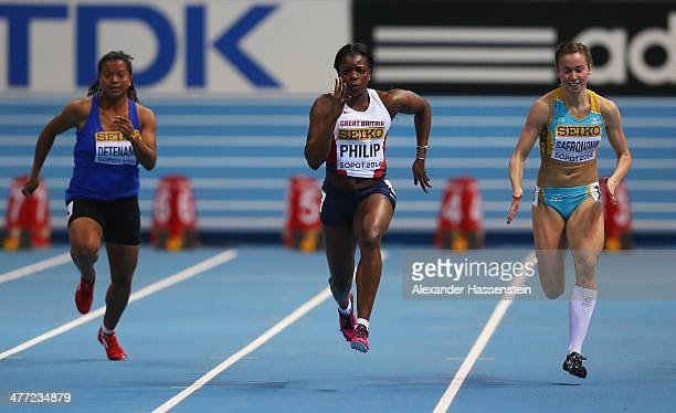 Asha Philip of Great Britain competes with Lovelite Detenamo of Nauru Pacific and Olga Safronova of Kazakhstan compete in the Women's 60m heats...