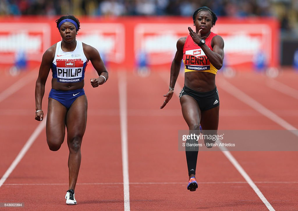 Asha Phillip and Desiree Henry of Great Britain compete in the women's 100m heats on day two of the British Championships Birmingham at Alexander Stadium on June 25, 2016 in Birmingham, England.