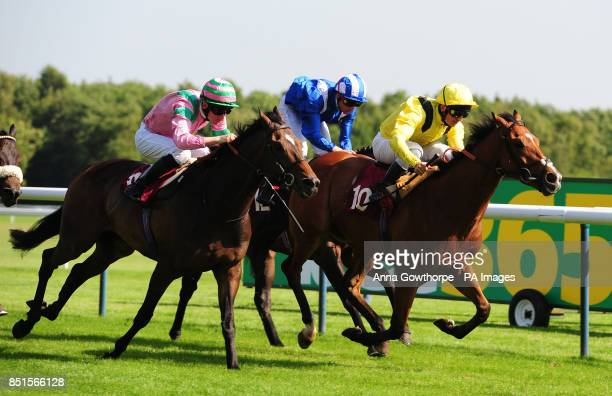 Ashaadd ridden by Andrea Atzeni wins the bet365 Handicap Stakes during the bet365 Old Newton Cup Day at Haydock Park Racecourse NewtonleWillows