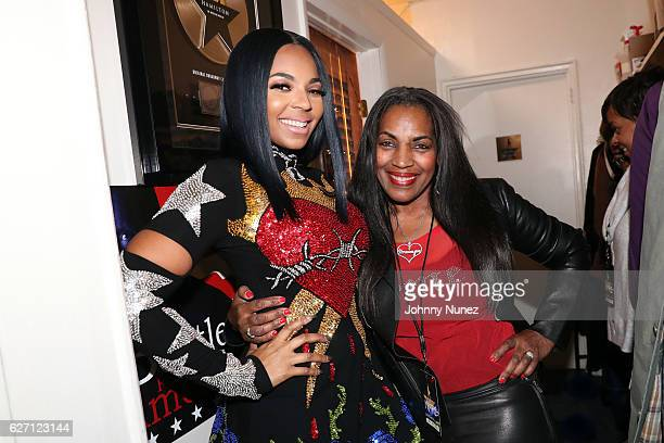 Ashanti and Tina Douglas backstage at The Hamilton Mixtape Live Performance on December 1 2016 in New York City